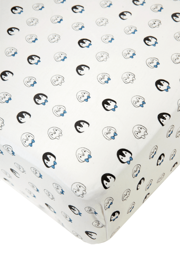 white and blue crib sheet